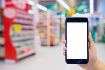 Woman hold mobile smartphone while shopping in supermarket
