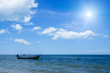 Fishing boat on the sea  with blue sky and sunlight.
