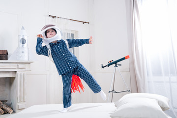 Cute little boy in space helmet playing astronaut