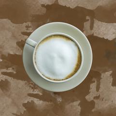 Milk coffee on brown background.