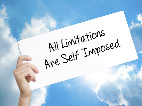 All Limitations Are Self Imposed Sign on white paper. Man Hand Holding Paper with text. Isolated on sky background