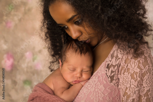 73dcde047e9 Beautiful African mother kissing her baby