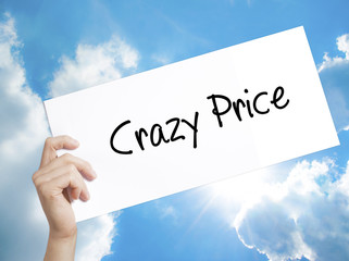 Crazy Price Sign on white paper. Man Hand Holding Paper with text. Isolated on sky background