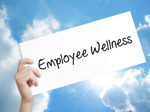 Employee Wellness Sign on white paper. Man Hand Holding Paper with text. Isolated on sky background