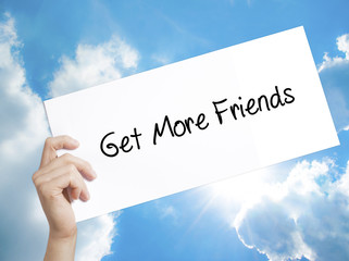 Get More Friends Sign on white paper. Man Hand Holding Paper with text. Isolated on sky background