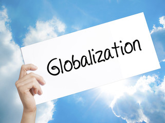 Globalization Sign on white paper. Man Hand Holding Paper with text. Isolated on sky background.