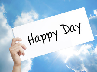 Happy Day Sign on white paper. Man Hand Holding Paper with text. Isolated on sky background