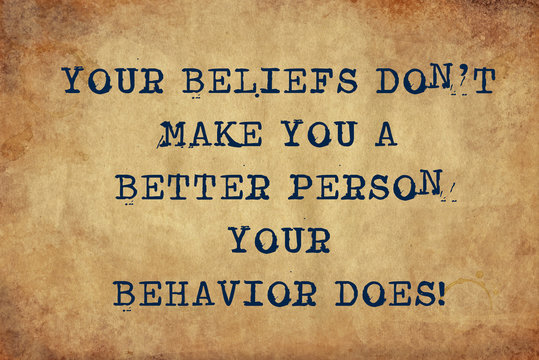 Inspiring motivation quote of your beliefs didn't make you a better person your behavior does with typewriter text. Distressed Old Paper with Typing image.