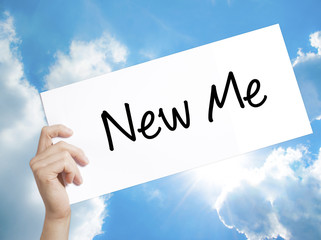 New Me Sign on white paper. Man Hand Holding Paper with text. Isolated on sky background
