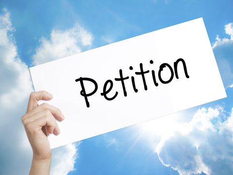 Petition Sign on white paper. Man Hand Holding Paper with text. Isolated on sky background