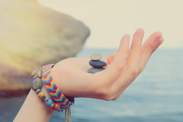 Summer Background - Sunny Day - Sunshine - Woman's hands with stones