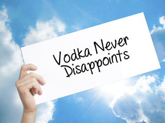 Vodka Never Disappoints Sign on white paper. Man Hand Holding Paper with text. Isolated on sky background