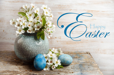 Happy Easter Greeting Card With And Eggs On Wooden Background Blooming Flowers In A