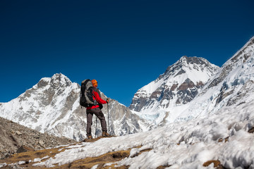 Trekker approaching PumoRi mountain in Khumbu valley on a way to Everest Base camp