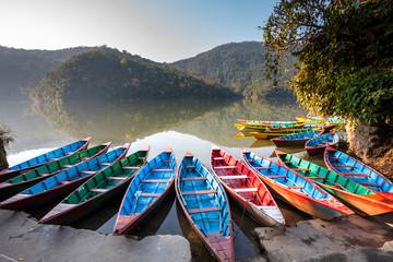 Fotobehang Nepal Colorful boats in Phewa lake in Pokhara, Nepal