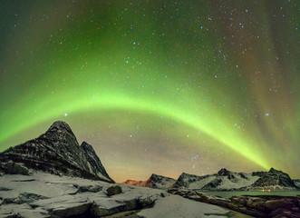 Aurora borealis (Polar lights). View to Steinfjord on Senja island - Lofoten islands, Norway