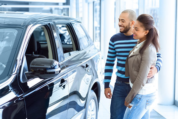 Beautiful African couple buying a car together