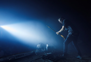 Guitarist performing on stage.
