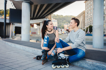 Holidays, active people and friendship concept. Young fit couple