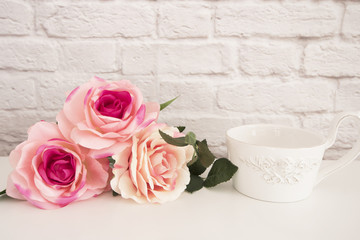Bouquet of roses on a white desk, A large cup of coffee in front angel, Romantic floral frame background, Floral Styled Wall Mock Up, Rose Flower Mockup, Valentine Mothers Day Card, Giftcard