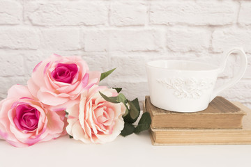 Bouquet of roses on a white desk, A large cup of coffee over old books, Romantic floral frame background, Floral Styled Wall Mock Up, Rose Flower Mockup, Valentine Mothers Day Card, Giftcard