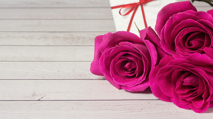 Romantic composition with rose flowers and gift St. Valentines Vedding Day background