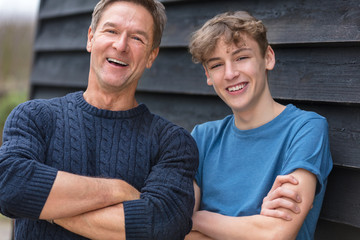 Happy Middle Aged Man Father and Teenage Son Arms Folded