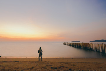 The silhouette of man standing alone at the beach, concept of lonely, sad, alone, person space, alone and scared