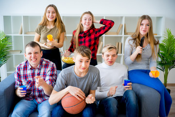 Friends watching basketball