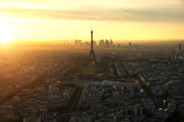Aerial view of Paris skyline with Eiffel Tower at sunset in Paris, France. Eiffel Tower is famous landmark in Paris.