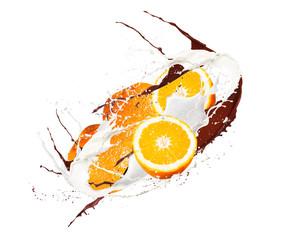Fruit, orange in milk splash, isolated on white background