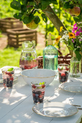 Preparations for dinner served in the garden in summer