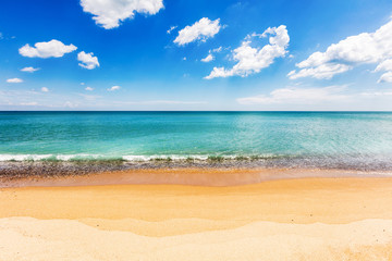 Simple beach view with azure sea and white clouds