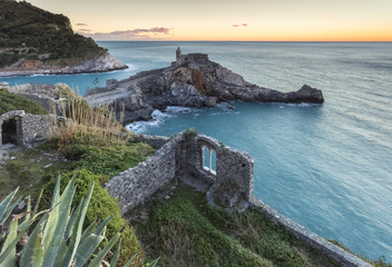 Sunset over ruins near the church of San Pietro, Porto Venere, Liguria, Italy.