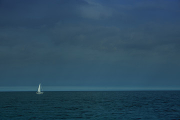 Lonely ship in the sea. The ship in sea for transtortation. Poland..