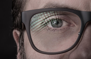 Eye and glasses - man's face close up (macro)