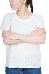 a corpus of a woman in a white t-shirt on a white background with folded arms on her chest