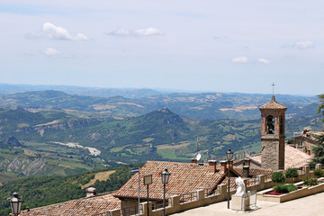 San Marino old church tower and hills landscape