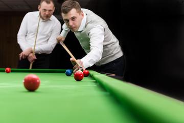 Game snooker billiards, athlete kick cue close up, selective focus