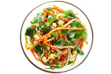 Thai salad from noodles raw carrots and cucumber with chickpeas, cilantro and sesame in sweet and sour sauce. Isolated on white, top view.