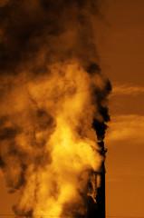 Factory Smokestack Chimney Piping Smoke Into the Air