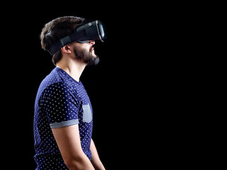 Man in blue dotted T-shirt wearing virtual reality 3d-headset
