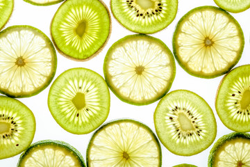Bright citrus lime and kiwi slices on white