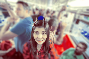 Woman with many people in electric train.