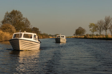 Typical motor boats on a canal in East Frisia