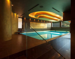 Swimming pool in a modern villa, nobody. Covered pool