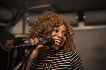 Singer performing in a recording studio