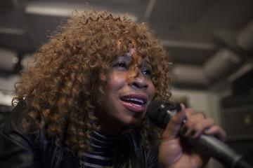 Singer performing in a recording studio
