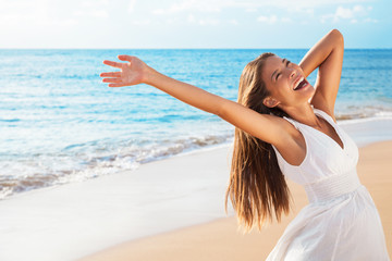 Wall Mural - Freedom woman on beach enjoying life with open arms feeling free bliss and success on beach. Happiness Asian girl in white summer dress enjoying ocean nature sunset during travel holidays vacation.