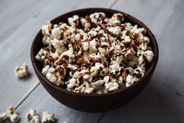 bowl with chocolate popcorn on wood